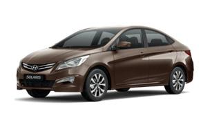 Коричневый Hyundai Solaris седан